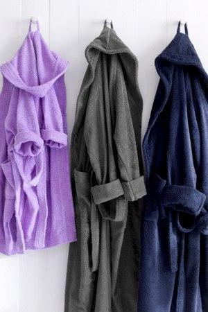 Our combed cotton toweling bathrobes with hood draws water away from kid's skin and hair.