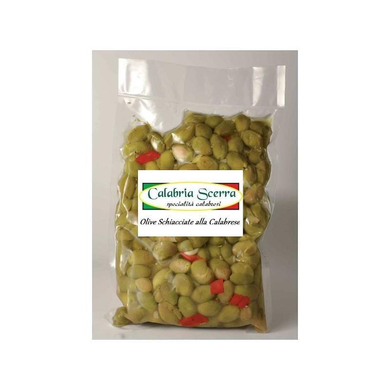 Olive verdi Schiacciate, olio di semi di girasole, peperoni, sale, semi di finocchio, aglio. Confezioni: Buste sottovuoto: ml. 500 / 1000 / 3000