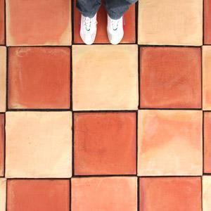 Artisan terracotta tiles in red and flame.
