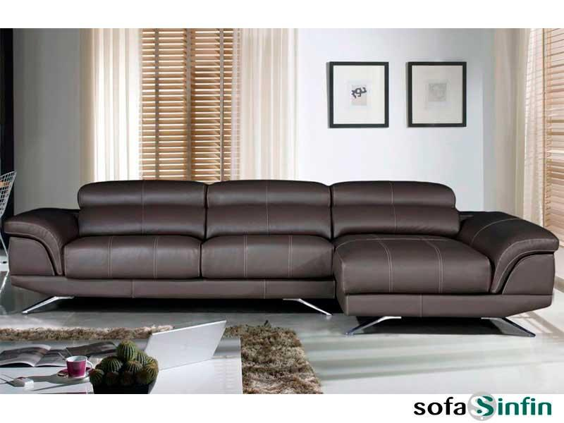 Sofas with chaise longue upholstered in leather and fabric.