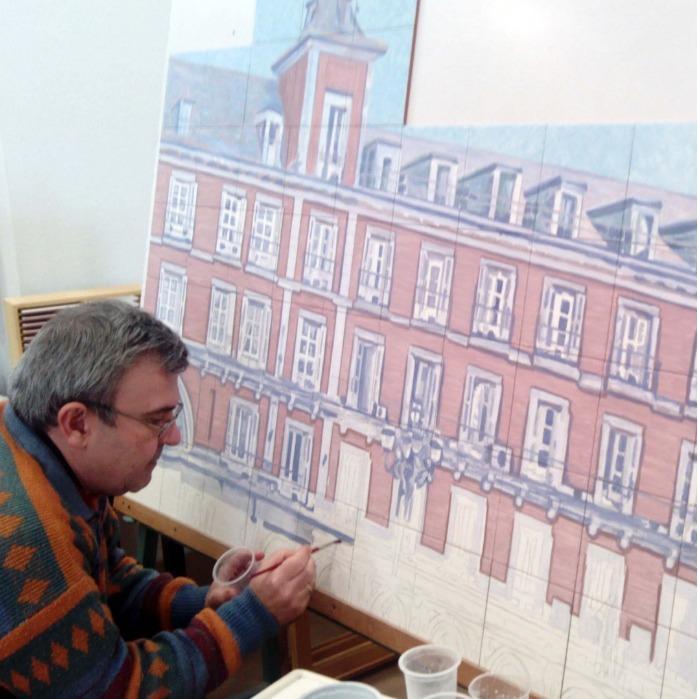 José Angulo painting in his studio