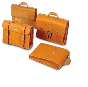 Exterior: Finest sleeked cowhide, at least 2 mm thick, vegetable barrel-tanned with aniline dye, making every bag a unique product. Finest metal fittings. Extras: Made in Germany.