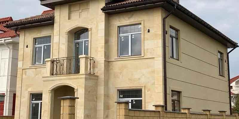 Finishing of the cottage facade in the Sauvignon housing estate, Odessa