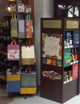 You'd increase the sales of your other goods as the gifts by creating a premium segment of gift wrapping in your store.