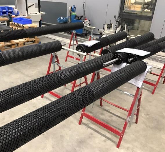 ESR spreader roller assembly