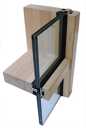 Curtain wall systems with timber load carrying elements and glass space of upto 64mm (Uw = 0,8W/m2K)