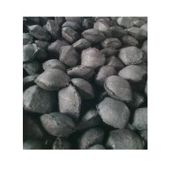 Charcoal briquettes in pad-form.