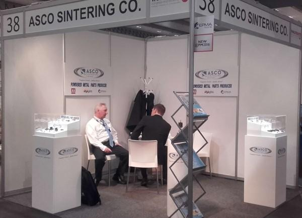 ASCO Sintering exhibit stand, displaying their Global Industry range of sintered products at the World PM 2016 in Hamburg, Germany.