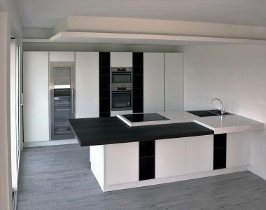 Kitchen with white glass doors and okite top