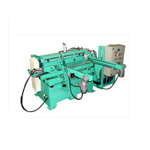 Automatic milling-copying machine with loader and adjustable heads. It is particularly suitable for the mass production of straight shaped pieces such as: hammer, axe, mallet and tool handles, etc.