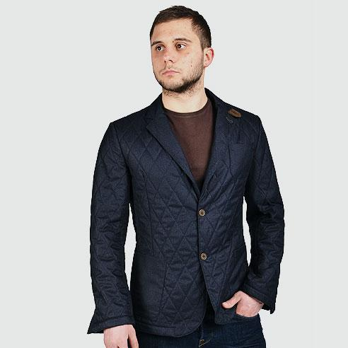 Waterproof quilted cotton blazer with suede trim.