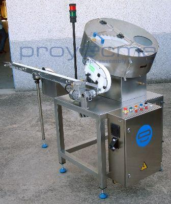 Proyecma designs and manufactures a wide range of cap feeders for different caps and speeds. The feeder is supplied stand alone or with table, hooper-elevator, outlet conveyor, etc.