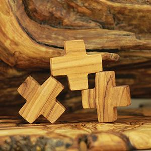 Symmetric small olive wood crosses. We can make any design or any size of olive wood small crosses.
