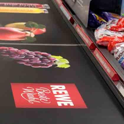 This supermarket shows its trademark on a PRINTBAND conveyer belt. Its trademark is mixed with fruits and brands printed on the PRINTBAND.