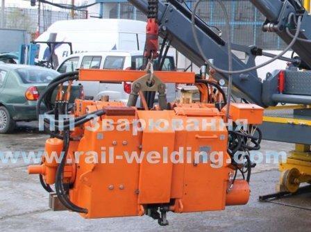 suspended machine for flash batt welding of rails