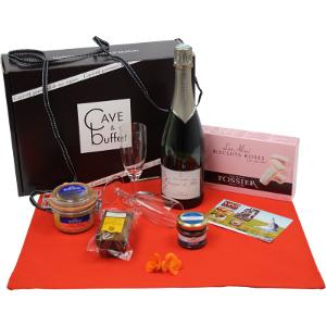 A special food hamper with bottle of Champagne and foie gras.