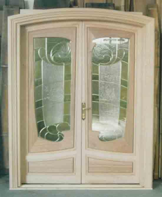 Entrance wood door with decorated windows