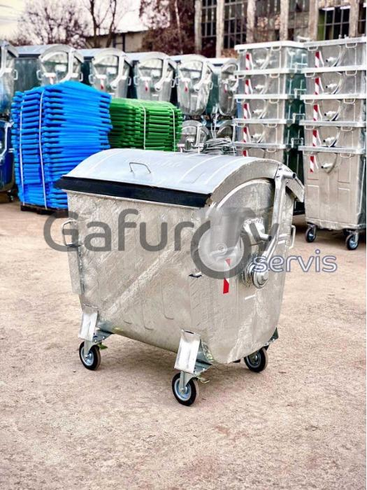 Metal waste container with round lid