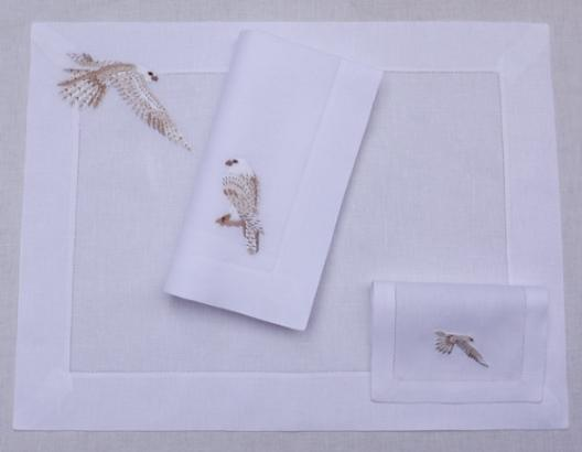 "Hand embroidered "" Falcon in white and silver "" on white linen with small hemstitch; there are available napkin 50x50cm; place mat 51x38cm nd cocktail napkin 15x22cm ;"