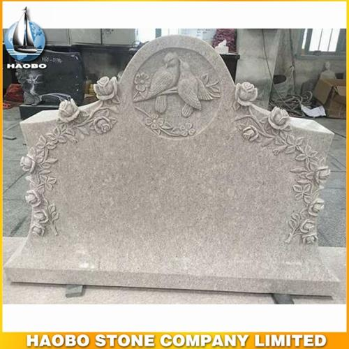 Pearl White Granite Tombstone With Carved Rose & Bird Design