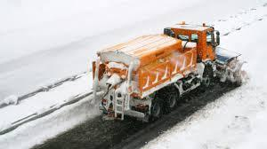 Tarpaulin cover for snow spreaders and ploughs -