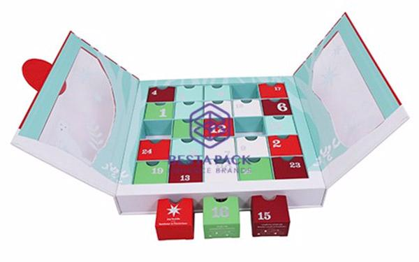 Advent calendar box with double-hinged lids - Box with PET window, board frame tray, dividers and 24 folding cartons