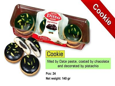 cookie - date paste center filled and chacolate coated and pistachio decorated cookie