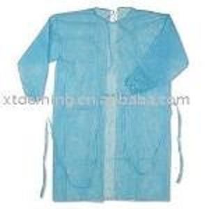 Vestido quirúrgico azul no tejido desechable con puños elást