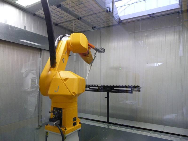 Wet paint coating with industrial robots - automation