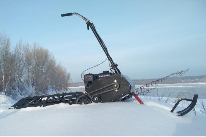"""Lightweight folding snowmobile """"Rusak"""" - Lightweight folding snowmobile """"Rusak"""" with a gasoline engine"""