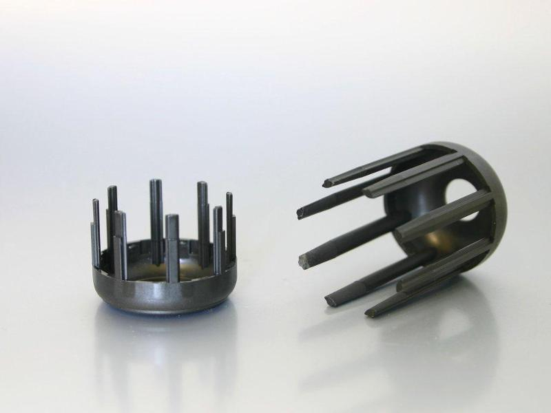 Plastic parts for electric motors - Slot wedge basket made of PA66 GF35
