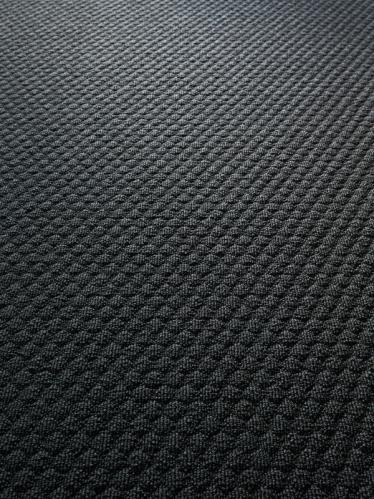 Buttons 900 - Wall-to-wall Carpet - A dance between light and shadows.