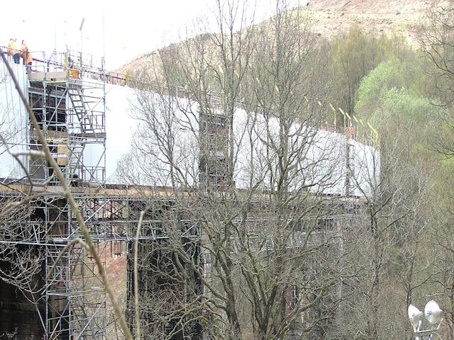 Scaffold encapsulation - To protect the environmental