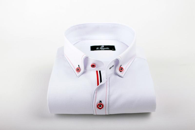 White shirt with navy blue and red contrast design.