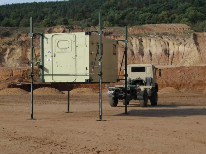Dispositivo de elevación 1889.10 - Dispositivos de elevación 1889.10 al elevar o bajar contenedores del camión