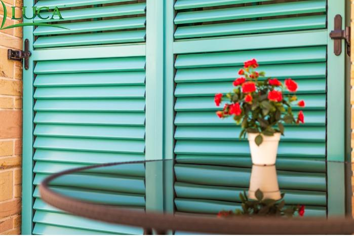 WOOD SHUTTERS -  WITH MOVABLE OR FIXED LAMELLAS