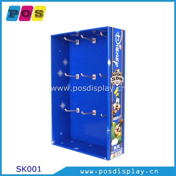 cardboard side kick display - cardboard side kick display with hooks for handing dolls