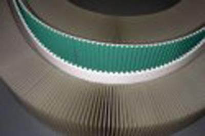 Profiles and cleats for timing belts - null