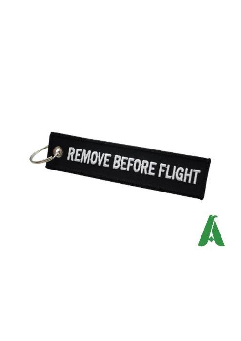 Portachiavi Remove before flight orginali - Portachiavi in tessuto con scritta Remove Before Flight