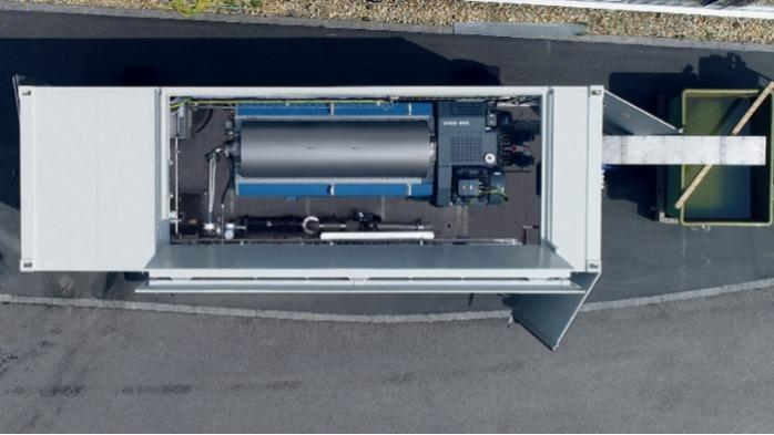 Mobile sludge dewatering by Flottweg - Mobile sludge dewatering in a container: connect and dewater