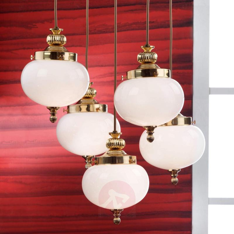 Extravagant Delia hanging light in polished brass - design-hotel-lighting