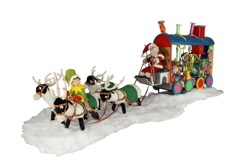 Reindeer group with Santa Claus and gift wrap wagon