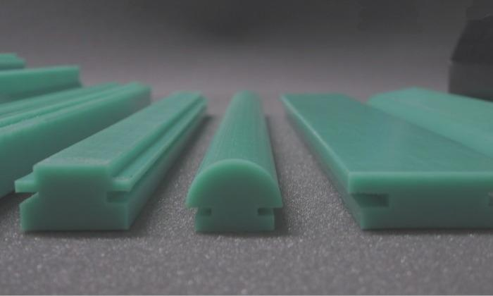 Chain- and sliding profiles - Chain guides with very low coefficient of sliding-friction