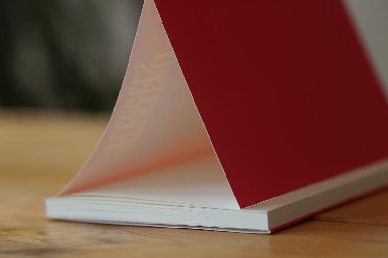 three softcover books - Book