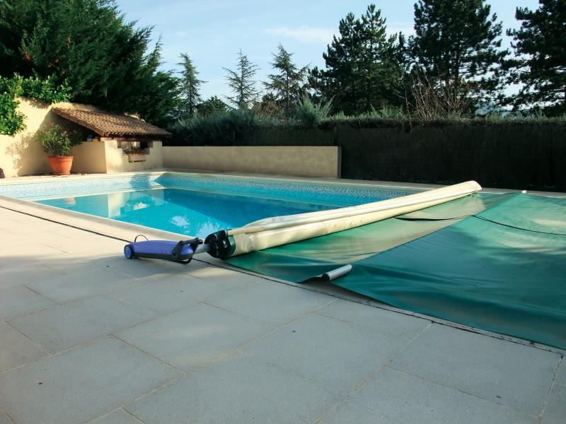 Couvertures pour piscines entreprises for Piscine bois 7x4