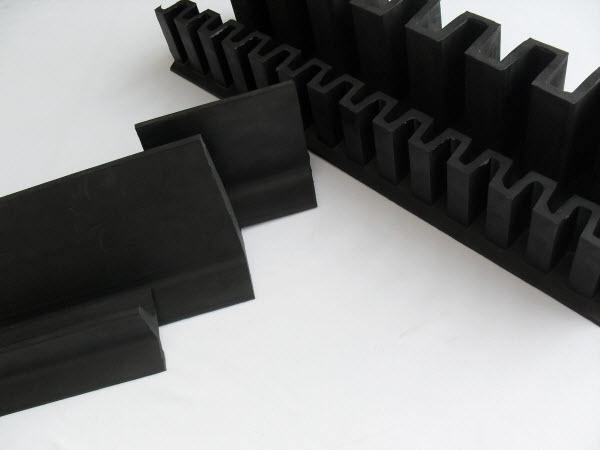 Conveyor belt cleats and corrugated sidewalls