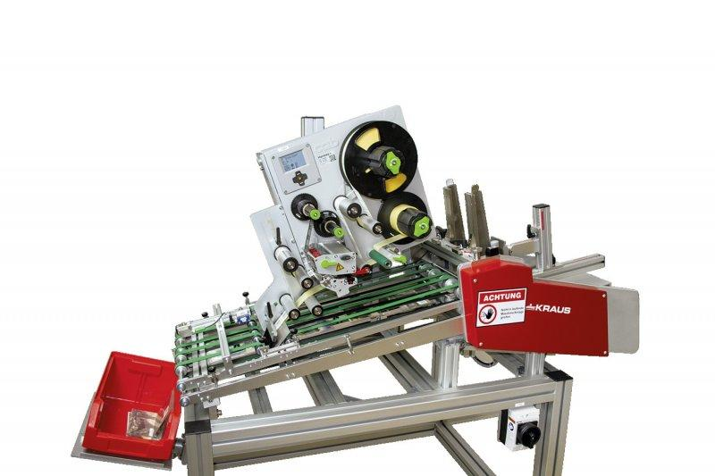 Fully automatic labelling of flat products HSFeco - Fully automatic top labelling of flat products - HSFeco