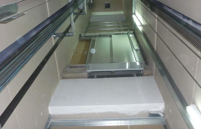 Protection feu 90 minutes entre niveaux dans une gaine d'ascenseur - null