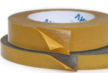 Double-sided adhesive tape - Double-sided adhesive tapes based on nonwoven fabrics