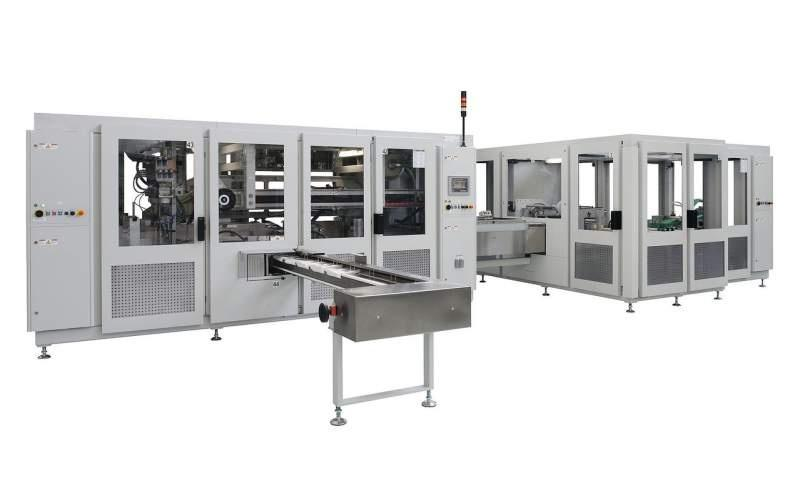 Packaging Machine OPTIMA HS/OSI - Packaging Machine OPTIMA HS/OSI: Bagger for Light Incontinence Products